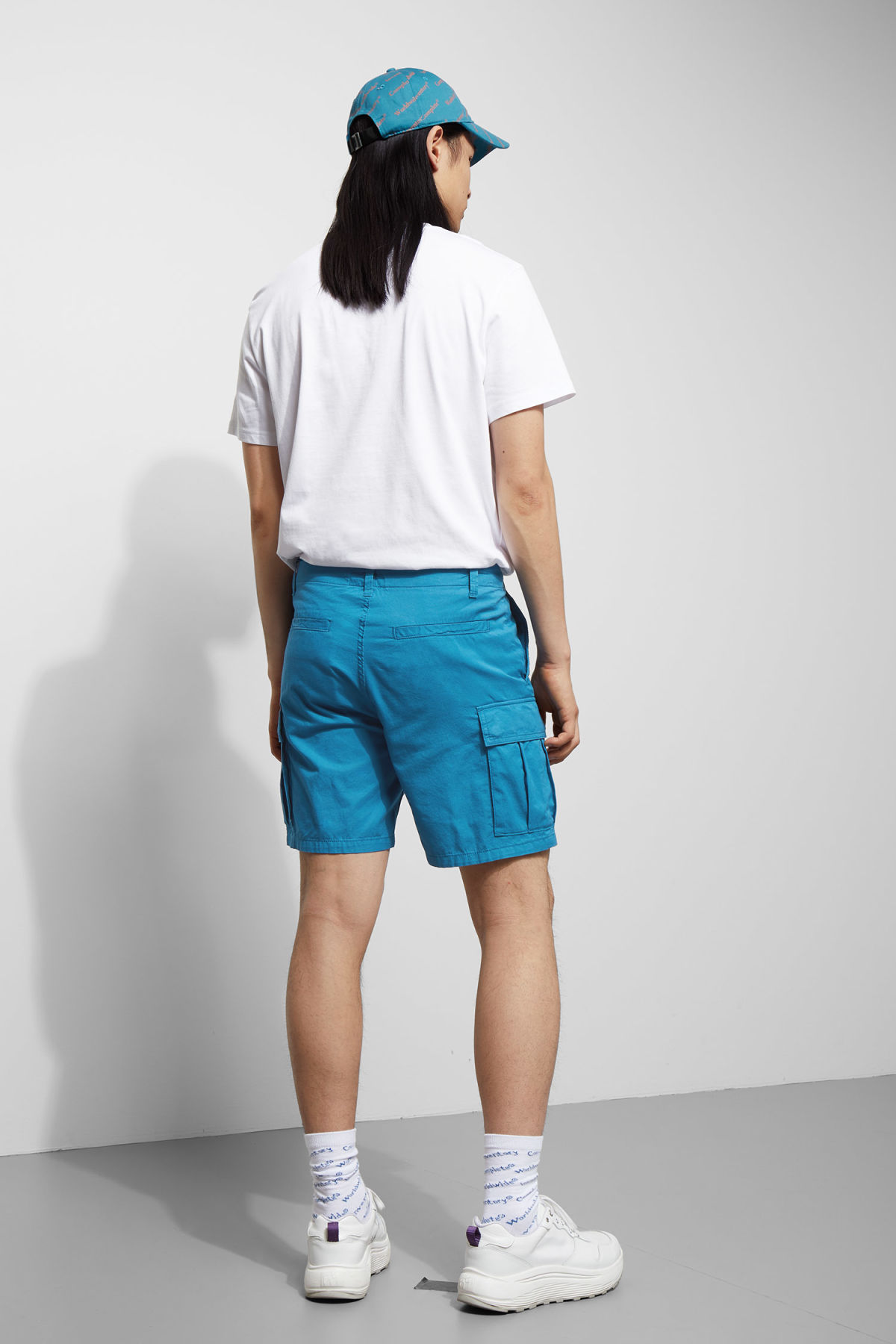 Model side image of Weekday norman shorts in blue