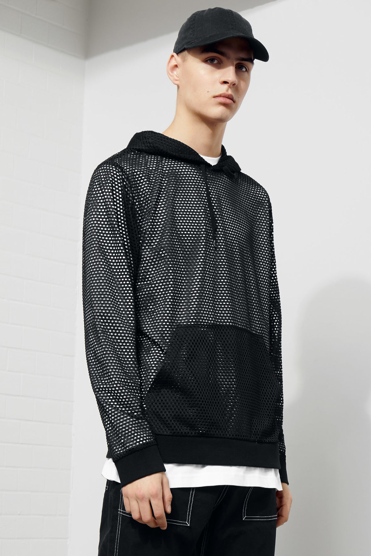 Model front image of Weekday kit mesh hoodie in black