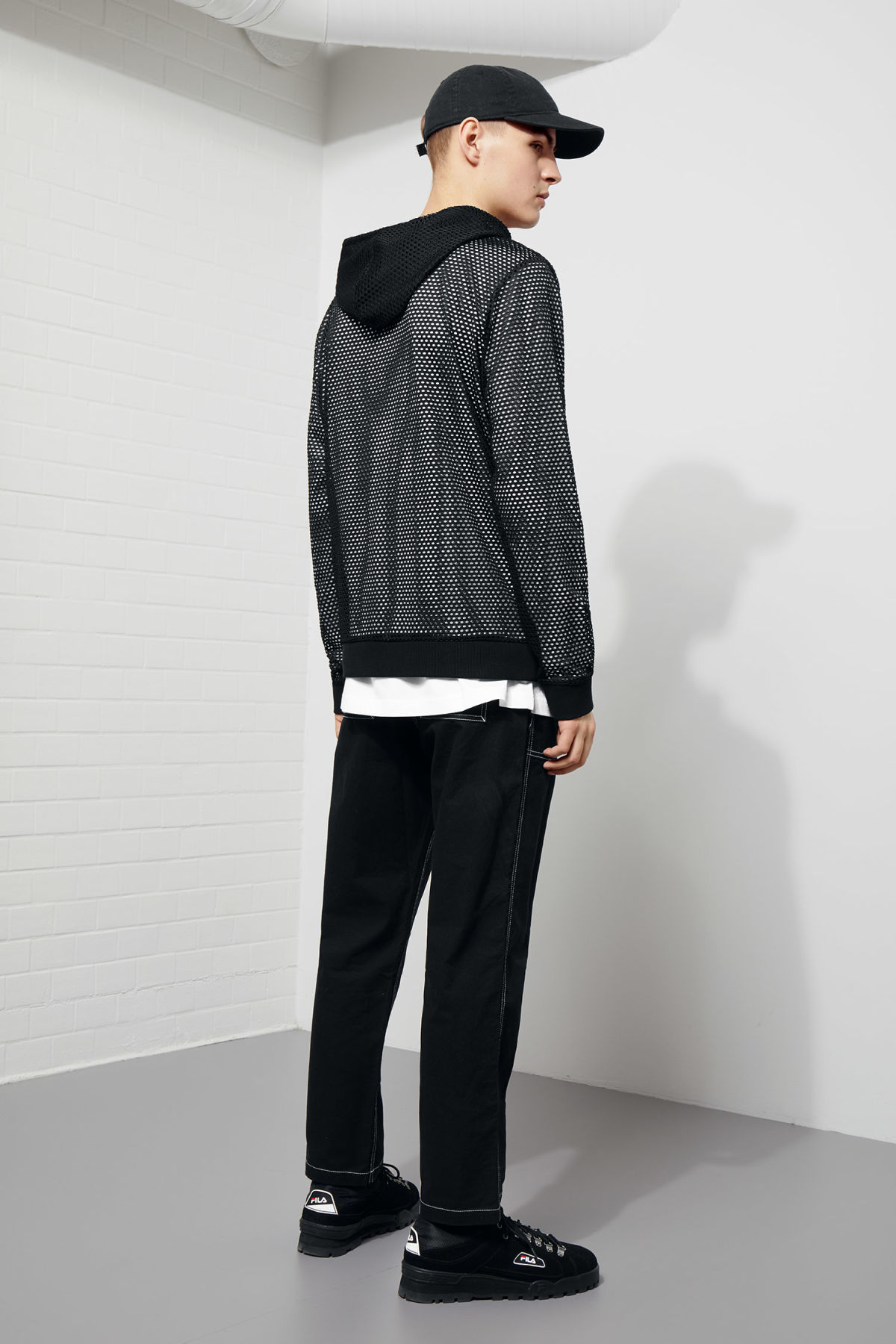 Model back image of Weekday kit mesh hoodie in black