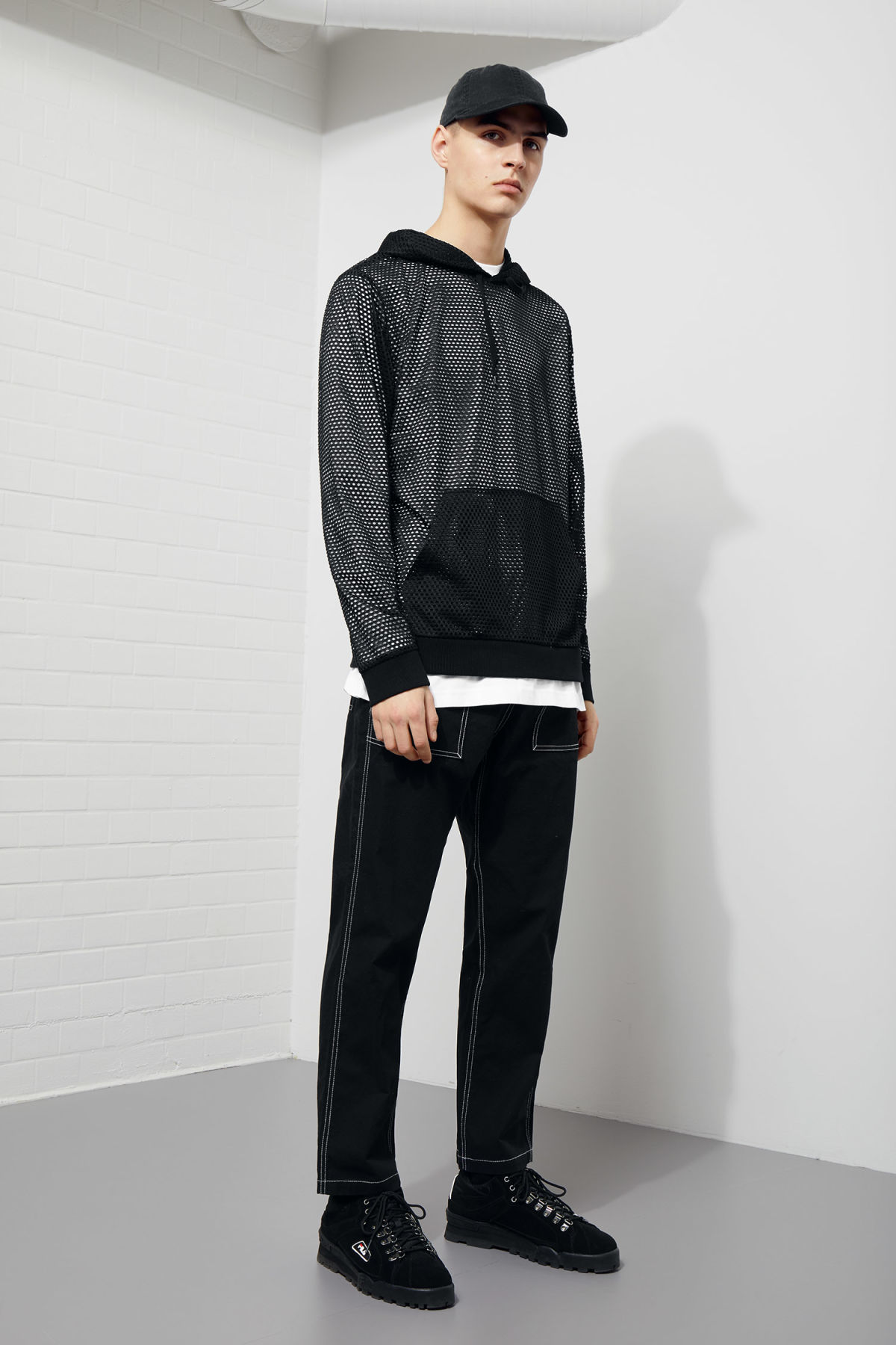 Model side image of Weekday kit mesh hoodie in black