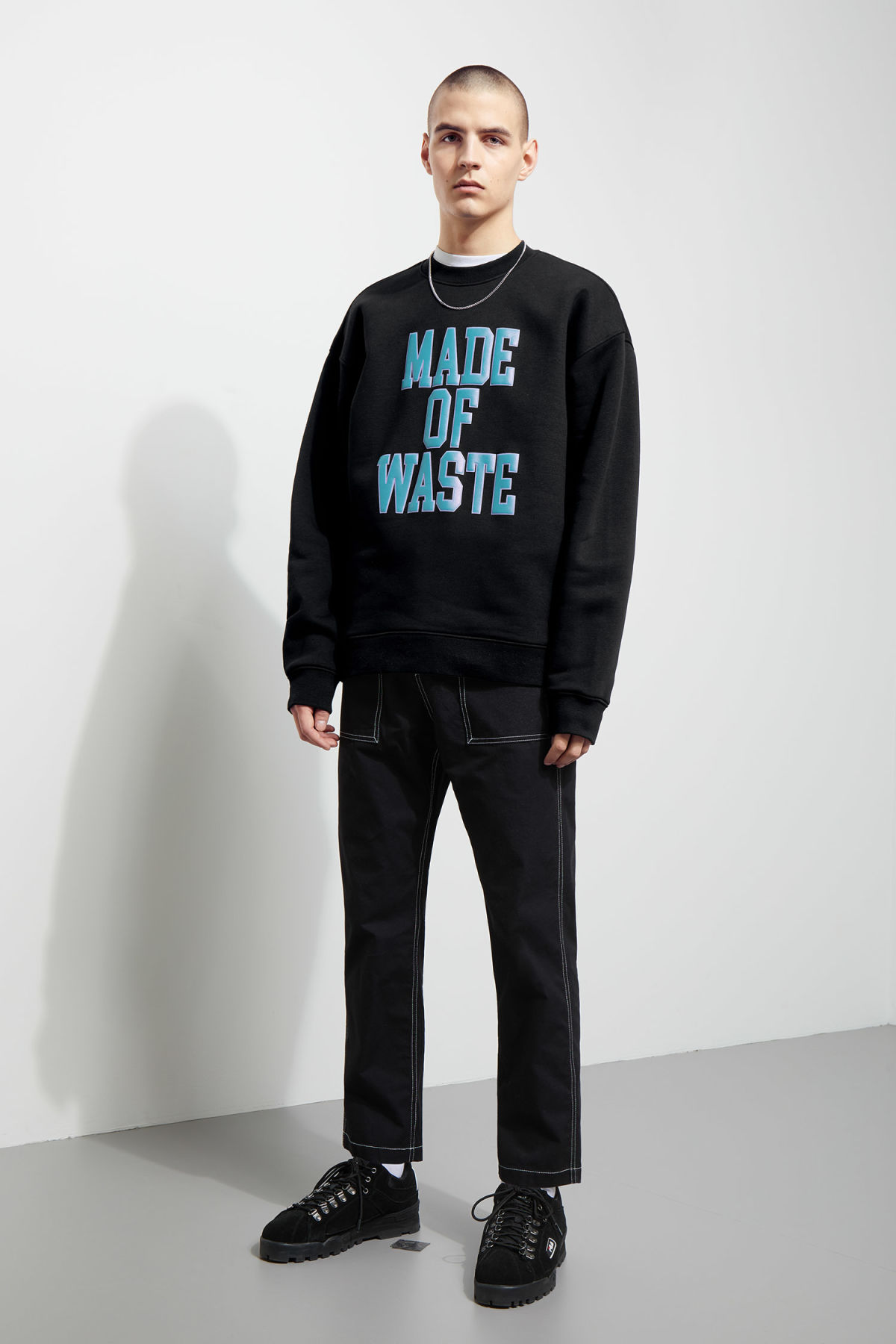 Model side image of Weekday big steve waste sweatshirt  in black