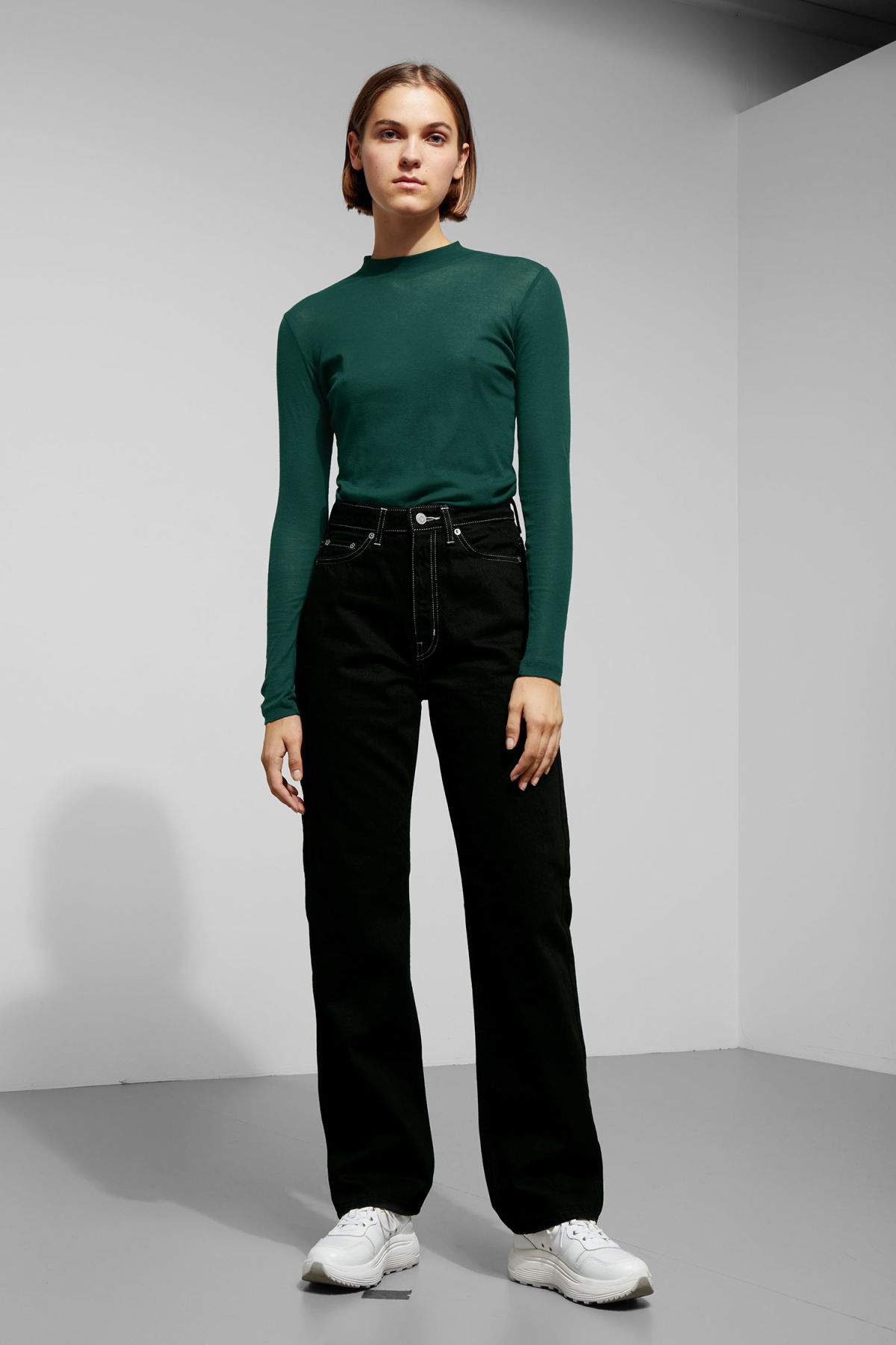 Model side image of Weekday meja long sleeve in green