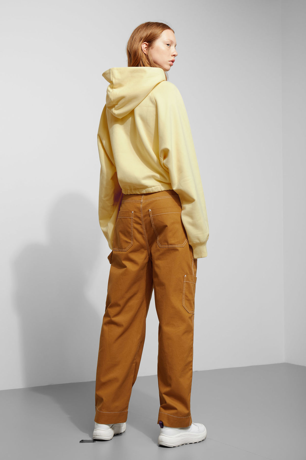 Model back image of Weekday center sweatshirt  in yellow