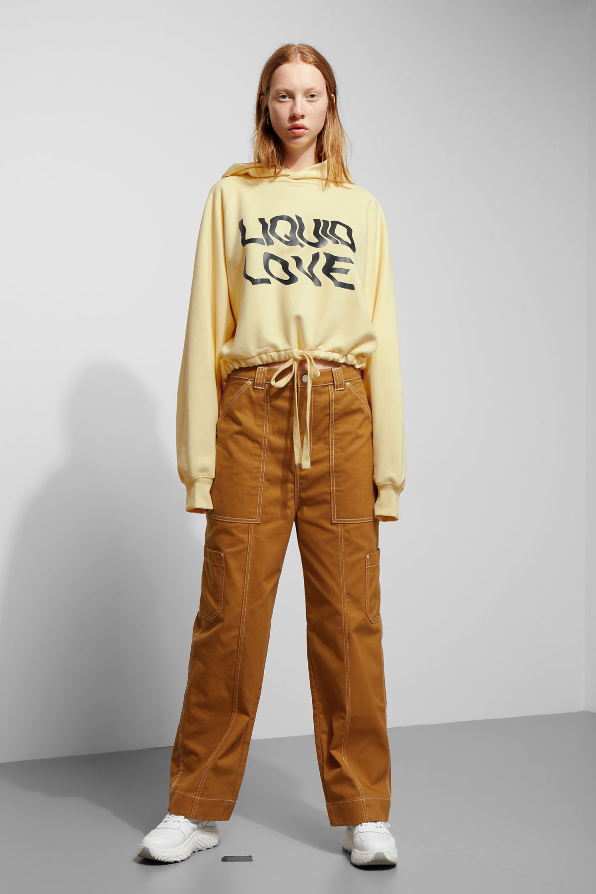 Model side image of Weekday center sweatshirt  in yellow