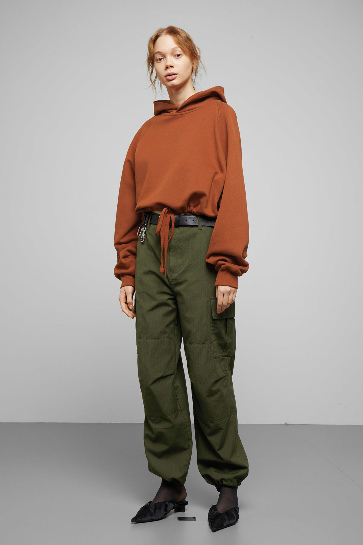 Model side image of Weekday center sweatshirt  in orange