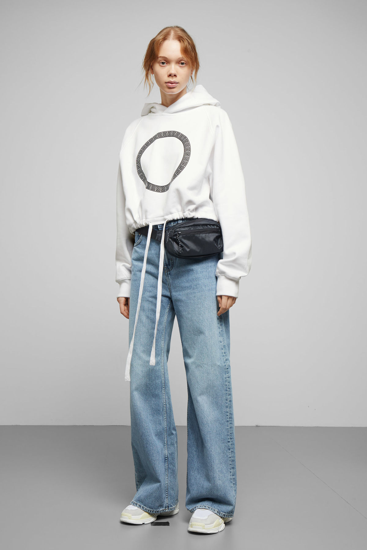 Model side image of Weekday center sweatshirt  in white