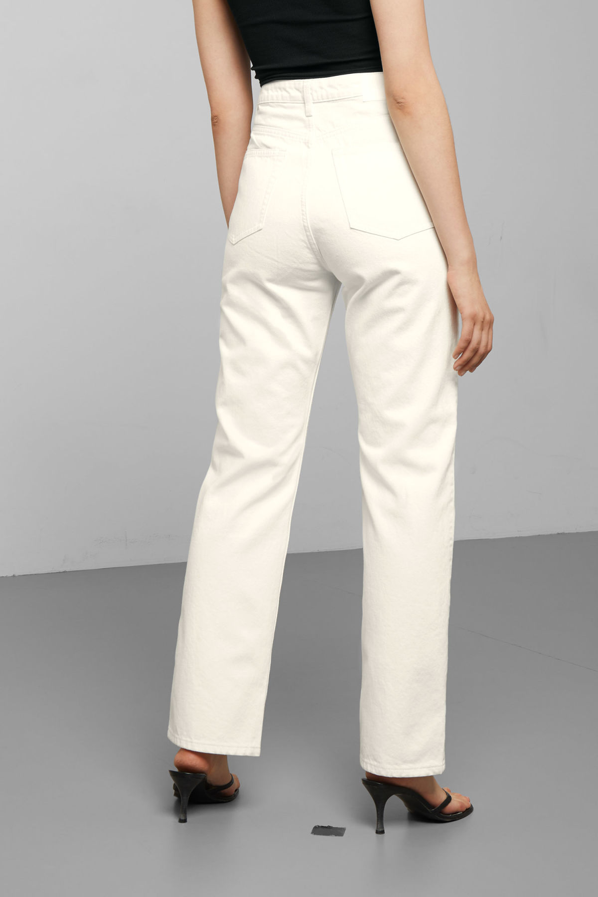 Model side image of Weekday row white jeans in white