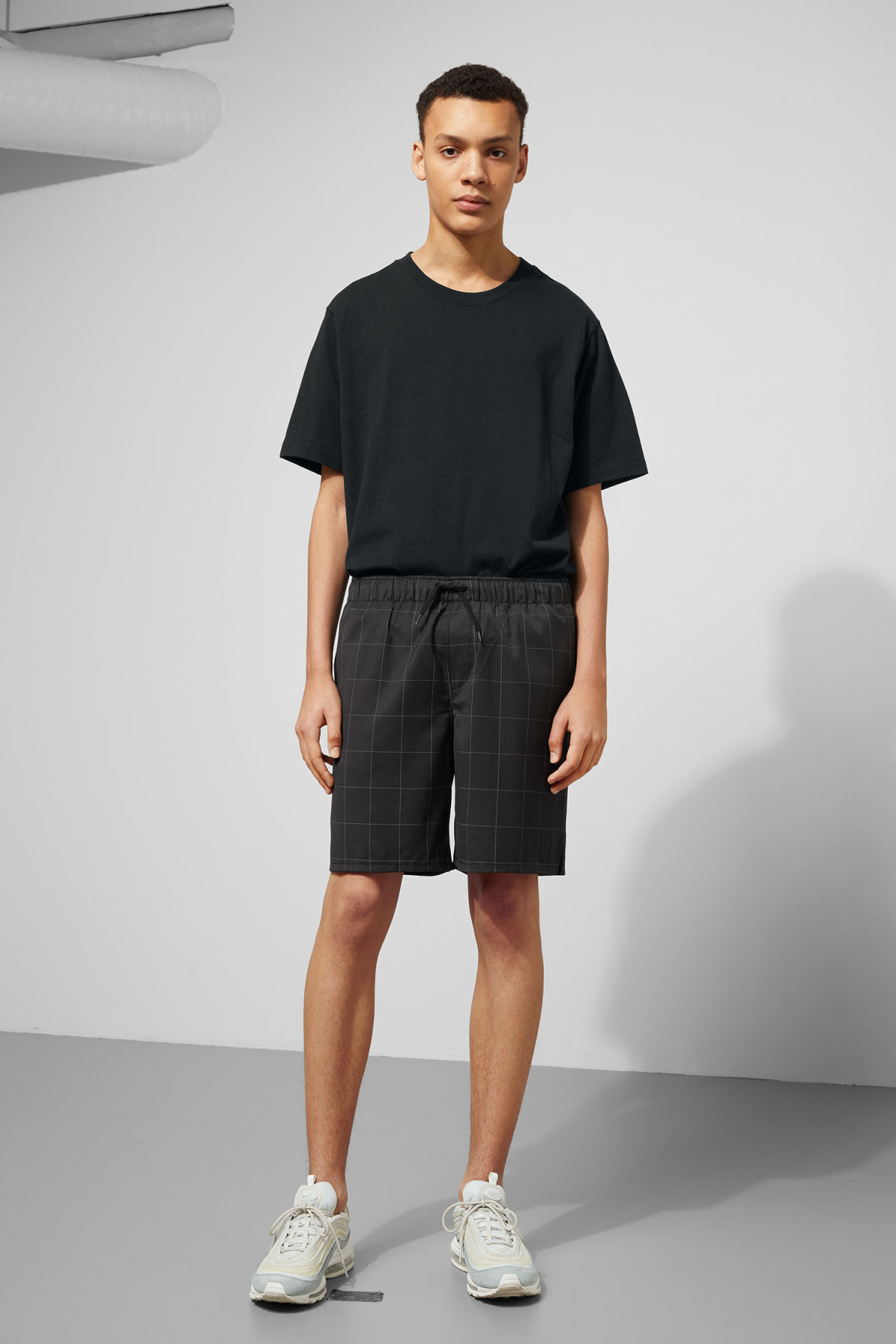 Model front image of Weekday pillar shorts in black