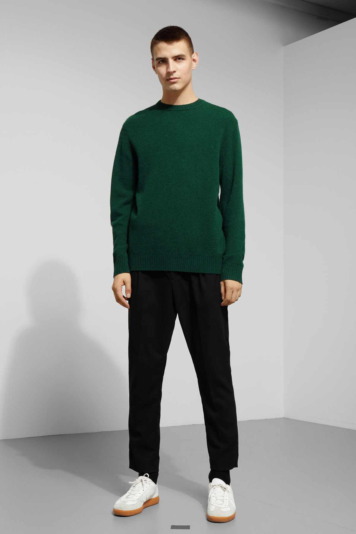 Model side image of Weekday richie wool sweater in green