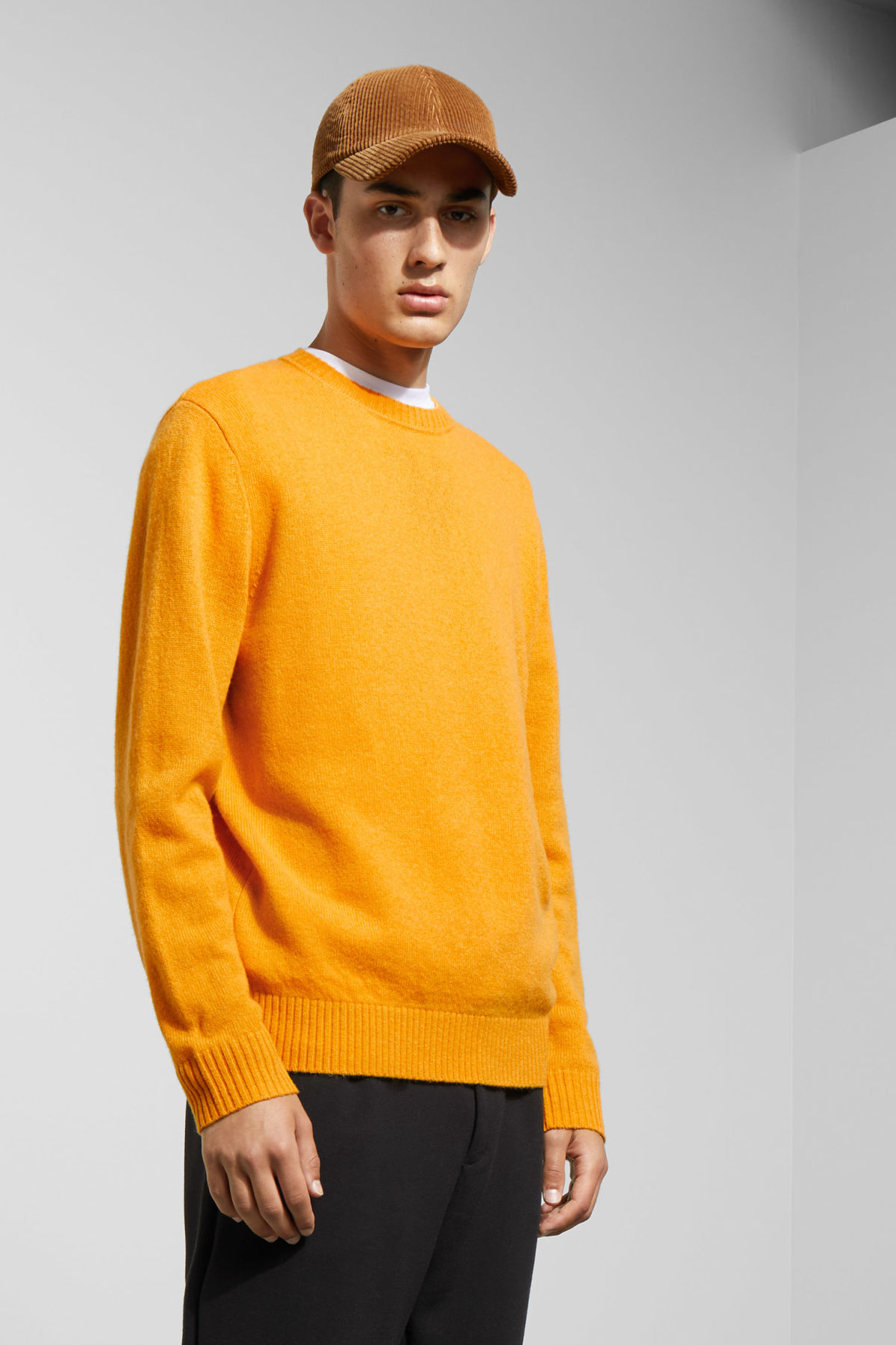 Model front image of Weekday richie wool sweater in yellow