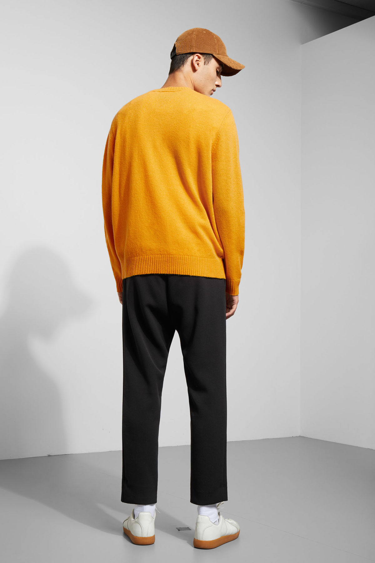 Model back image of Weekday richie wool sweater in yellow