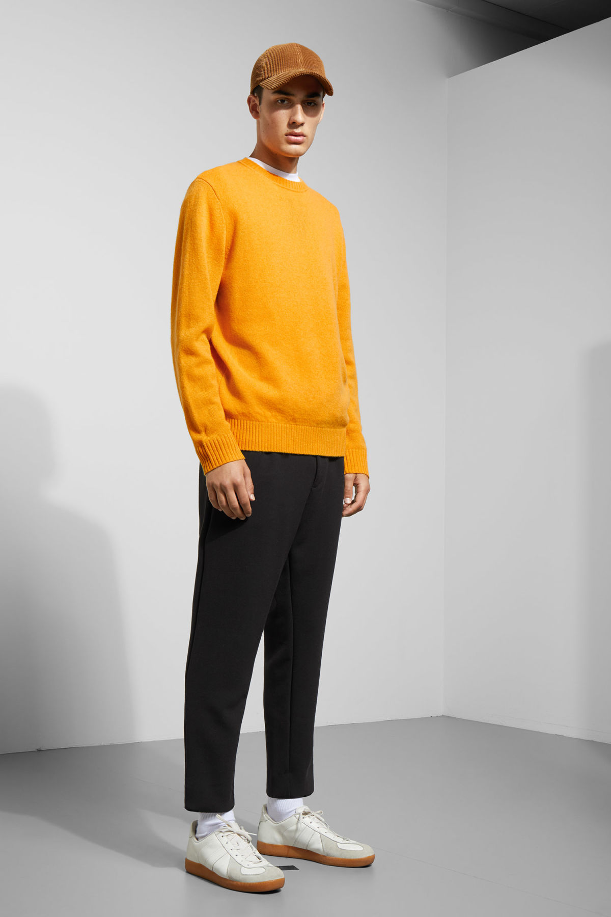 Model side image of Weekday richie wool sweater in yellow
