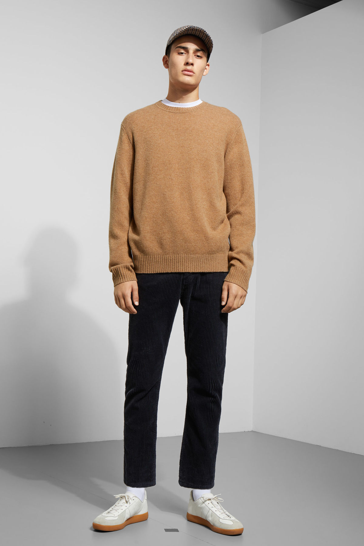 Model side image of Weekday richie wool sweater in beige