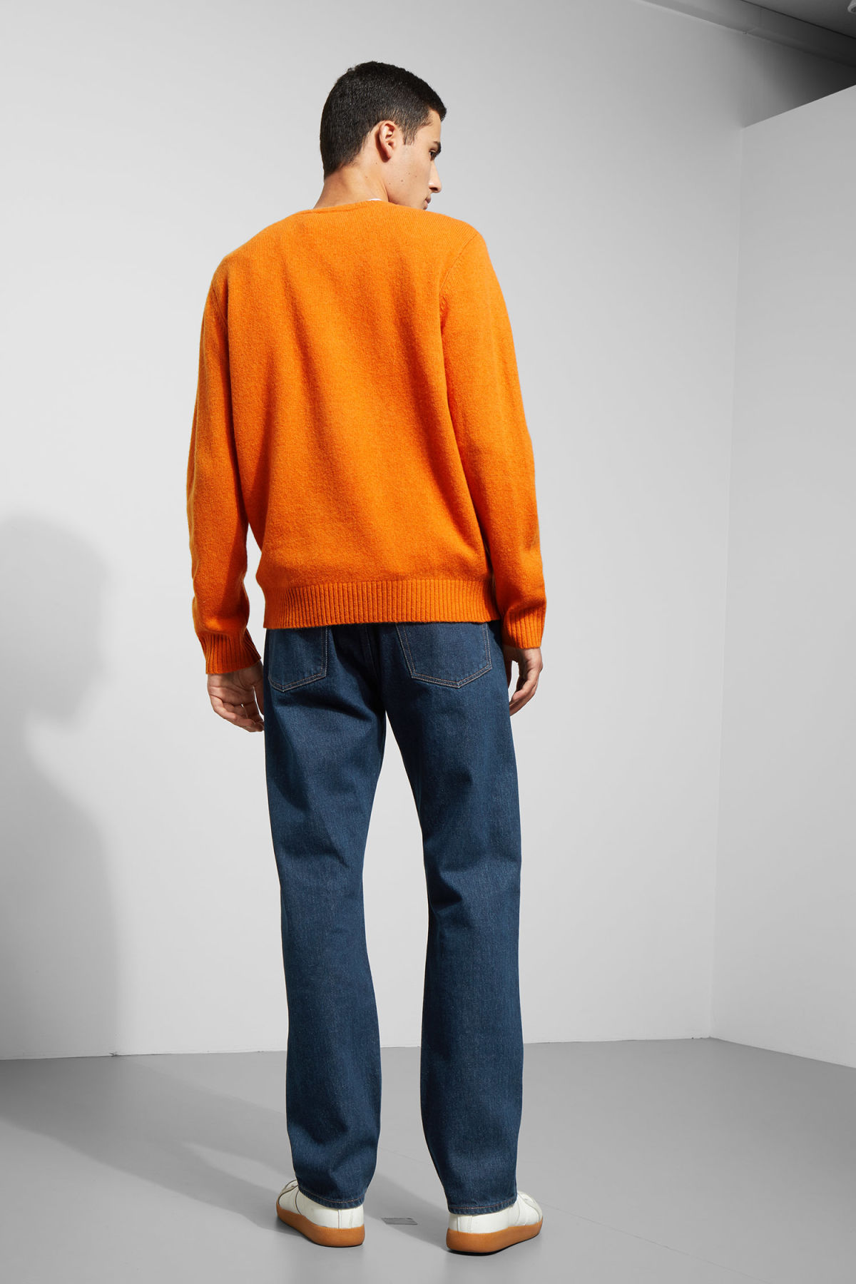 Model back image of Weekday richie wool sweater in orange