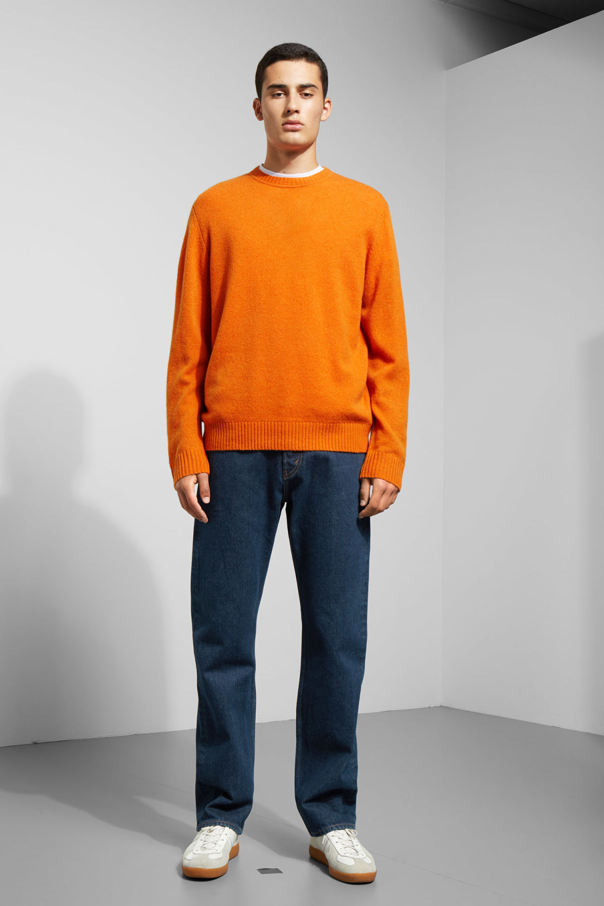 Model side image of Weekday richie wool sweater in orange