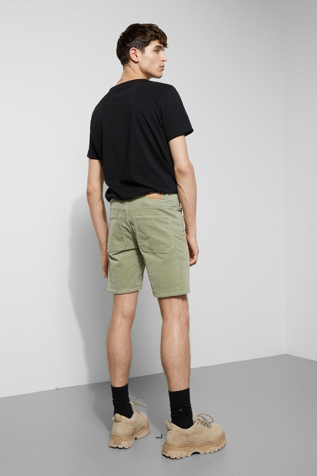 Model back image of Weekday lucas corduroy shorts in green