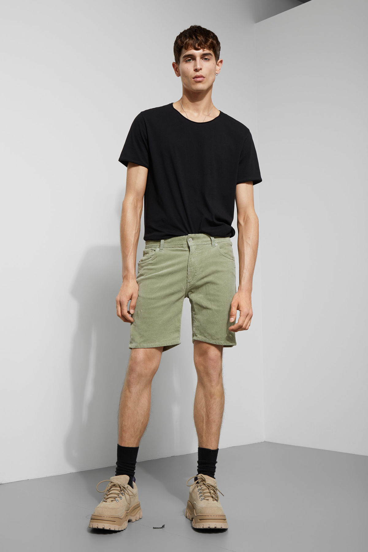 Model side image of Weekday lucas corduroy shorts in green