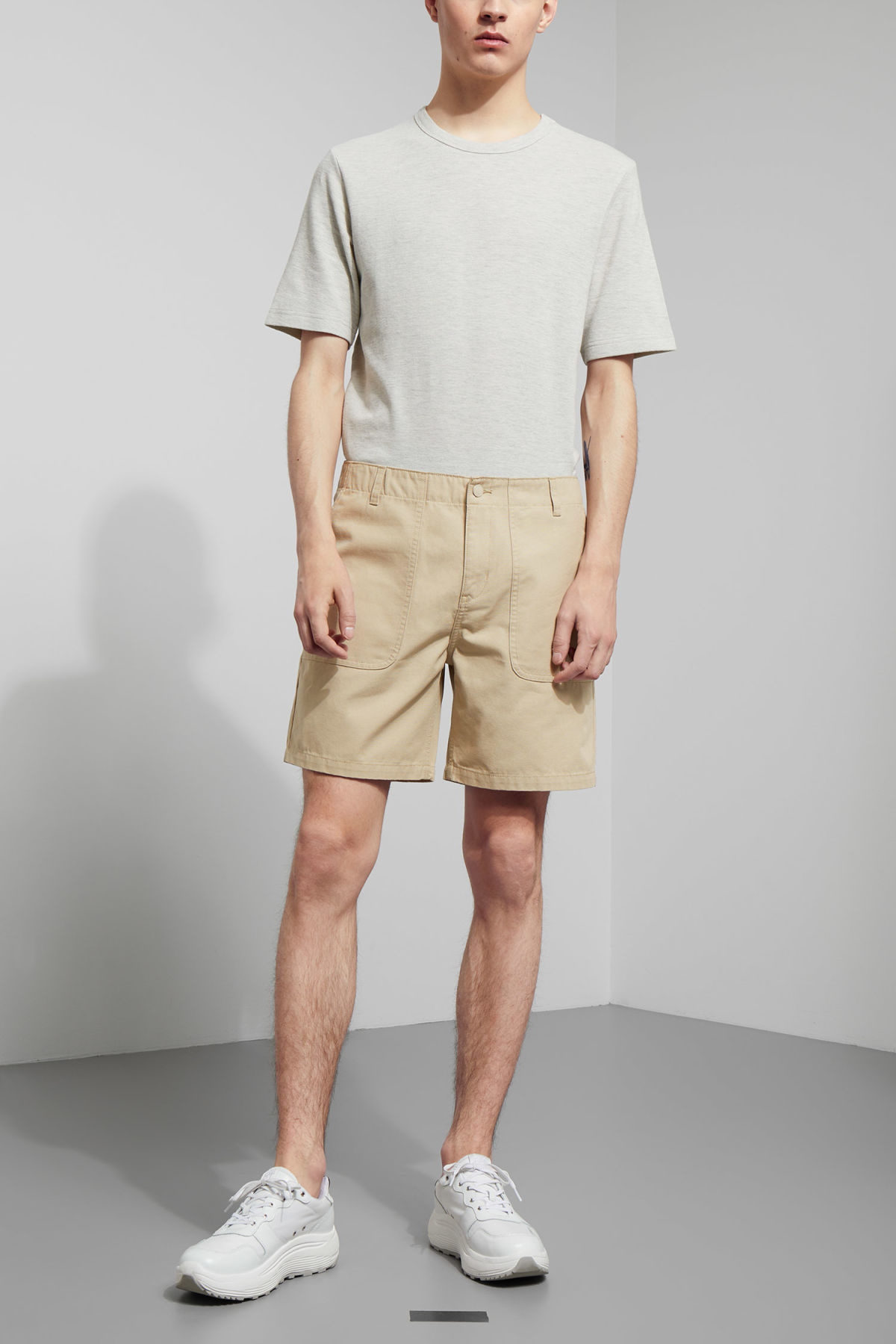 Model front image of Weekday james pocket shorts in beige