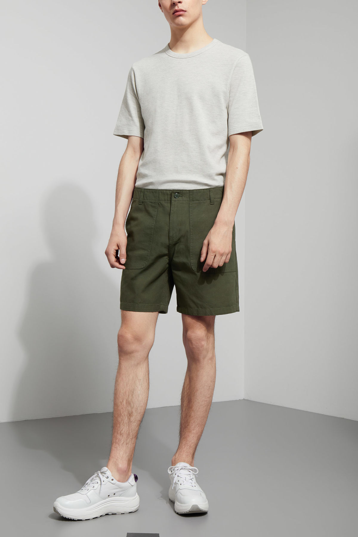 Model front image of Weekday james pocket shorts in green
