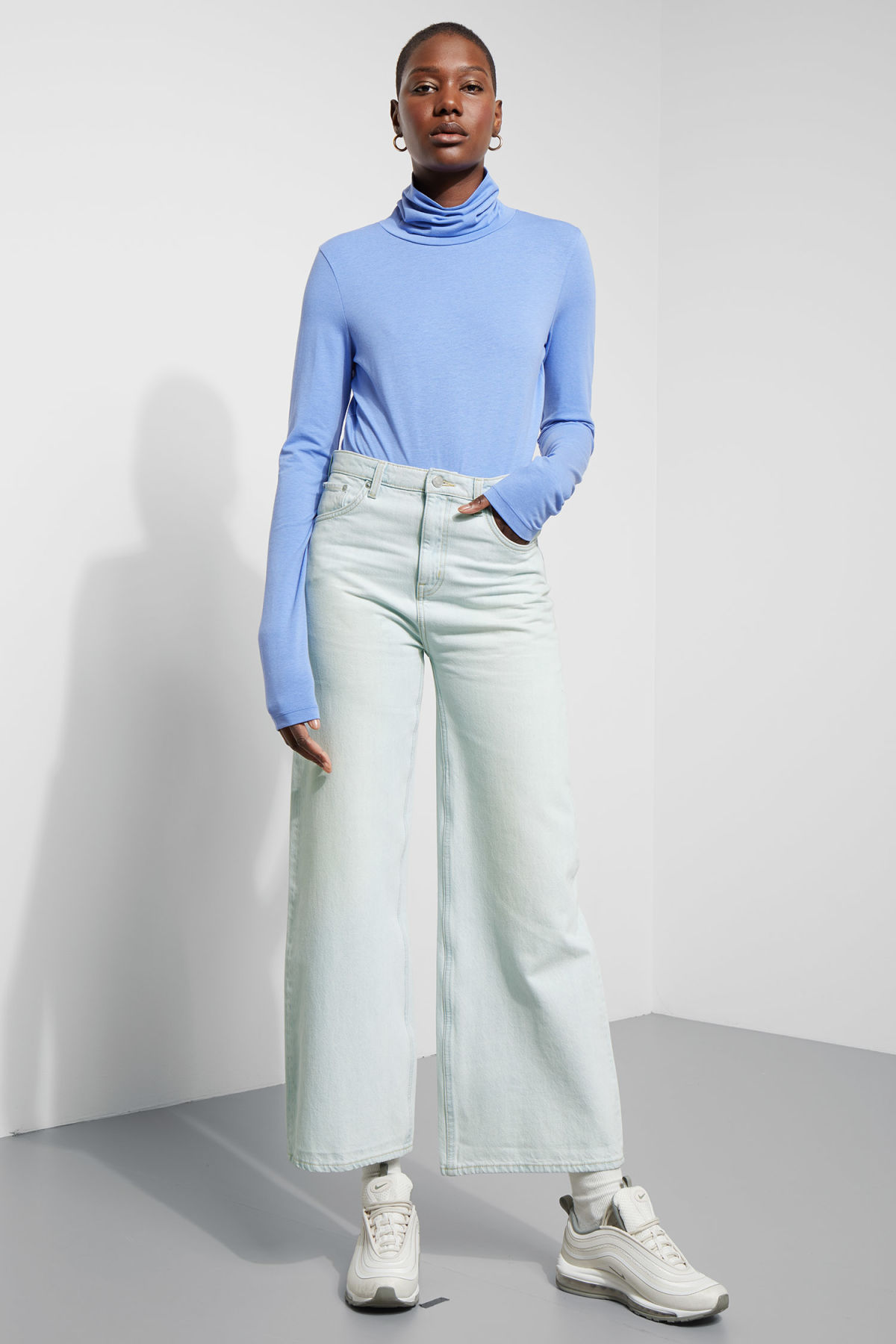 Model side image of Weekday alice turtleneck  in blue