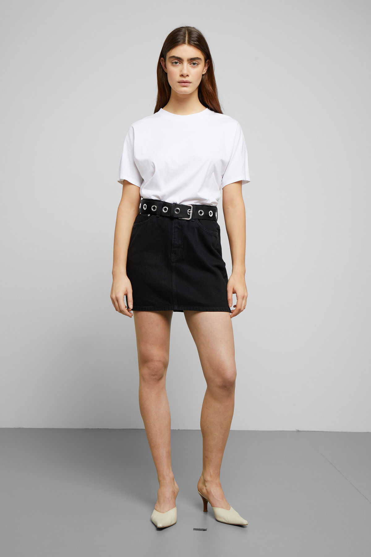 Model side image of Weekday wend black denim skirt  in black
