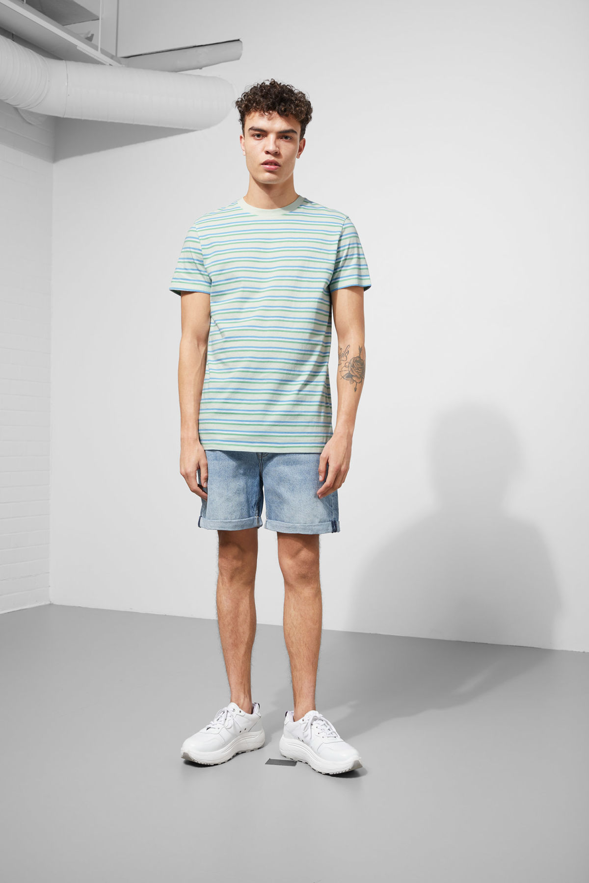 Model side image of Weekday alan stripe t-shirt in turquoise