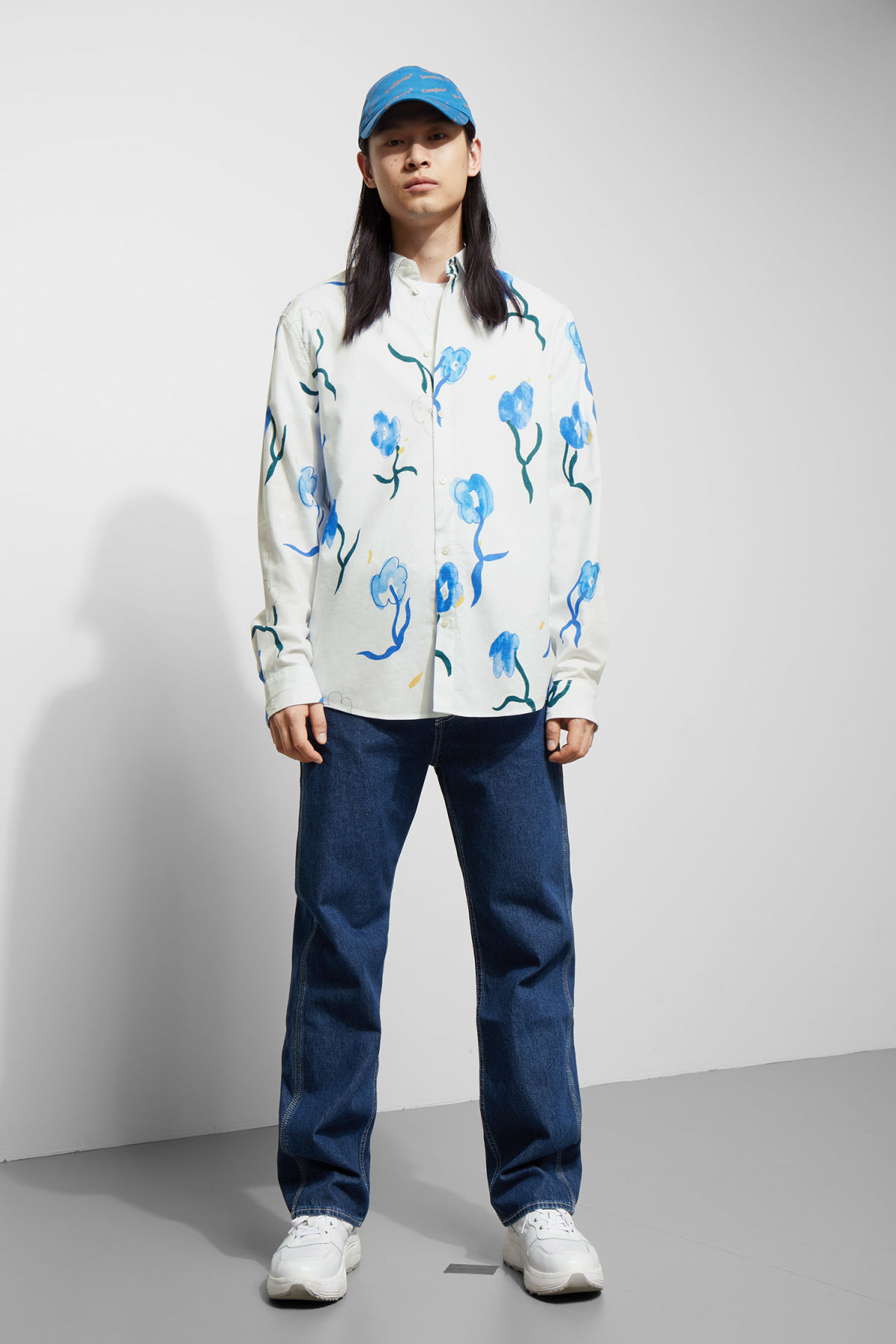 Model side image of Weekday lead water bloom shirt in white