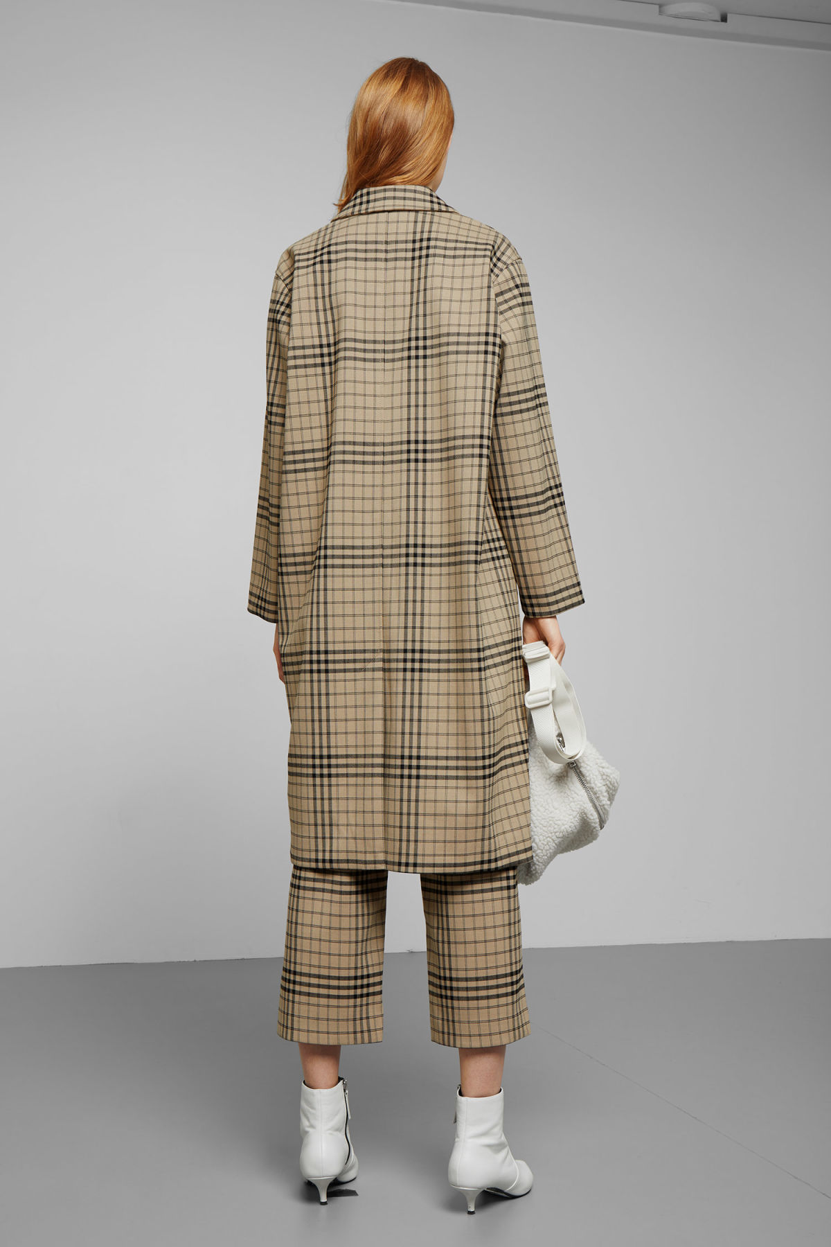 Model side image of Weekday lond checked coat in beige