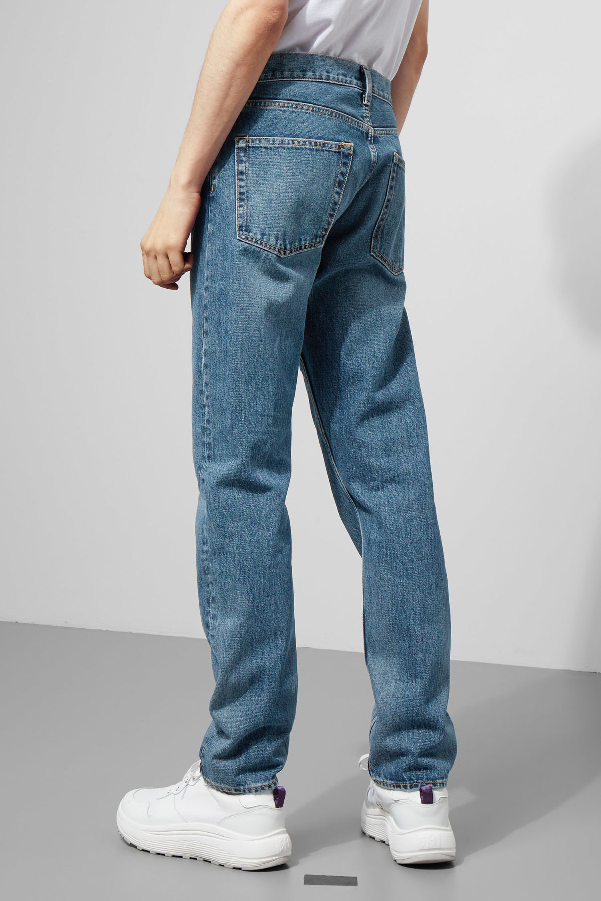Model side image of Weekday pine marwin blue jeans in blue