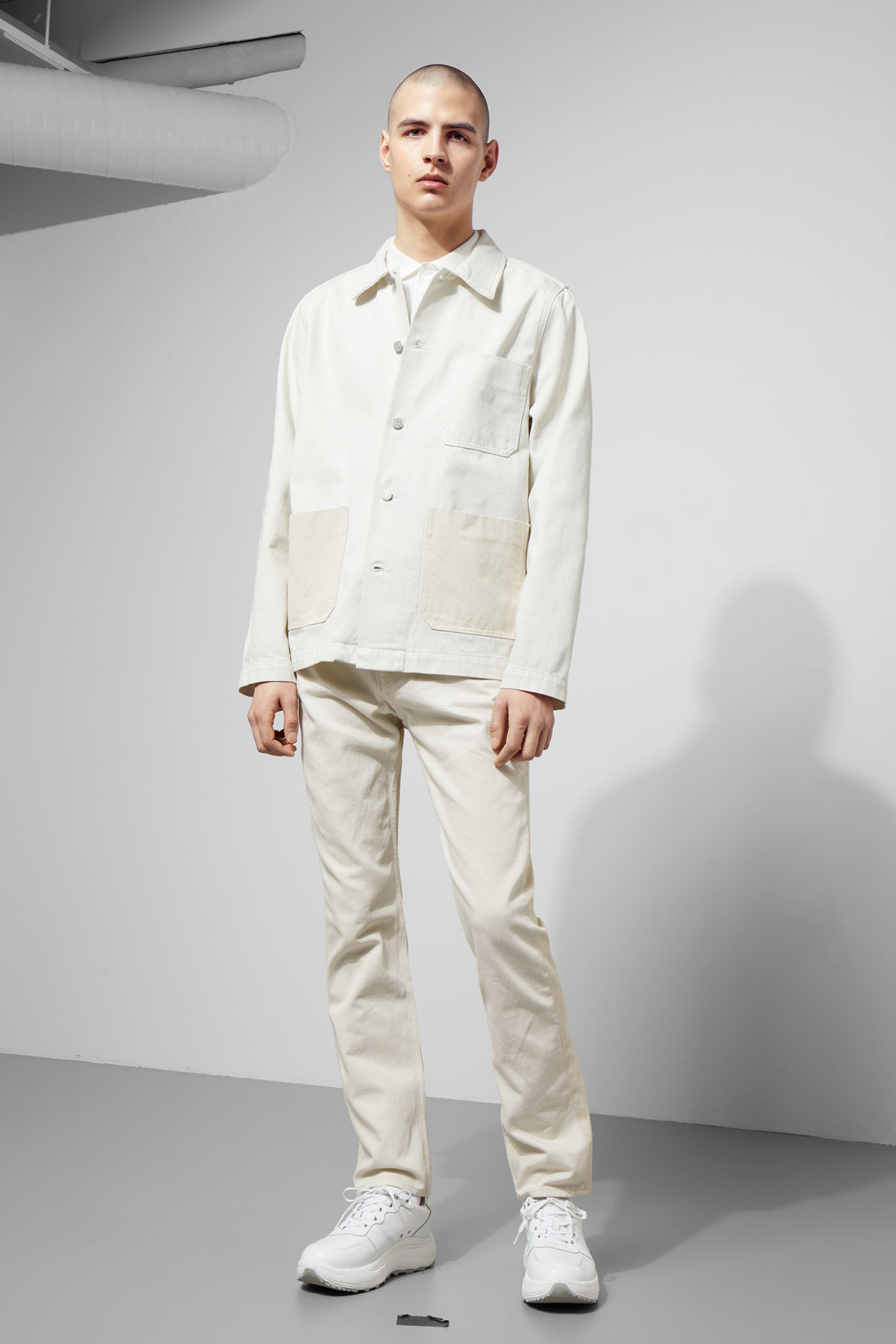 Model side image of Weekday generic two-toned jacket in white
