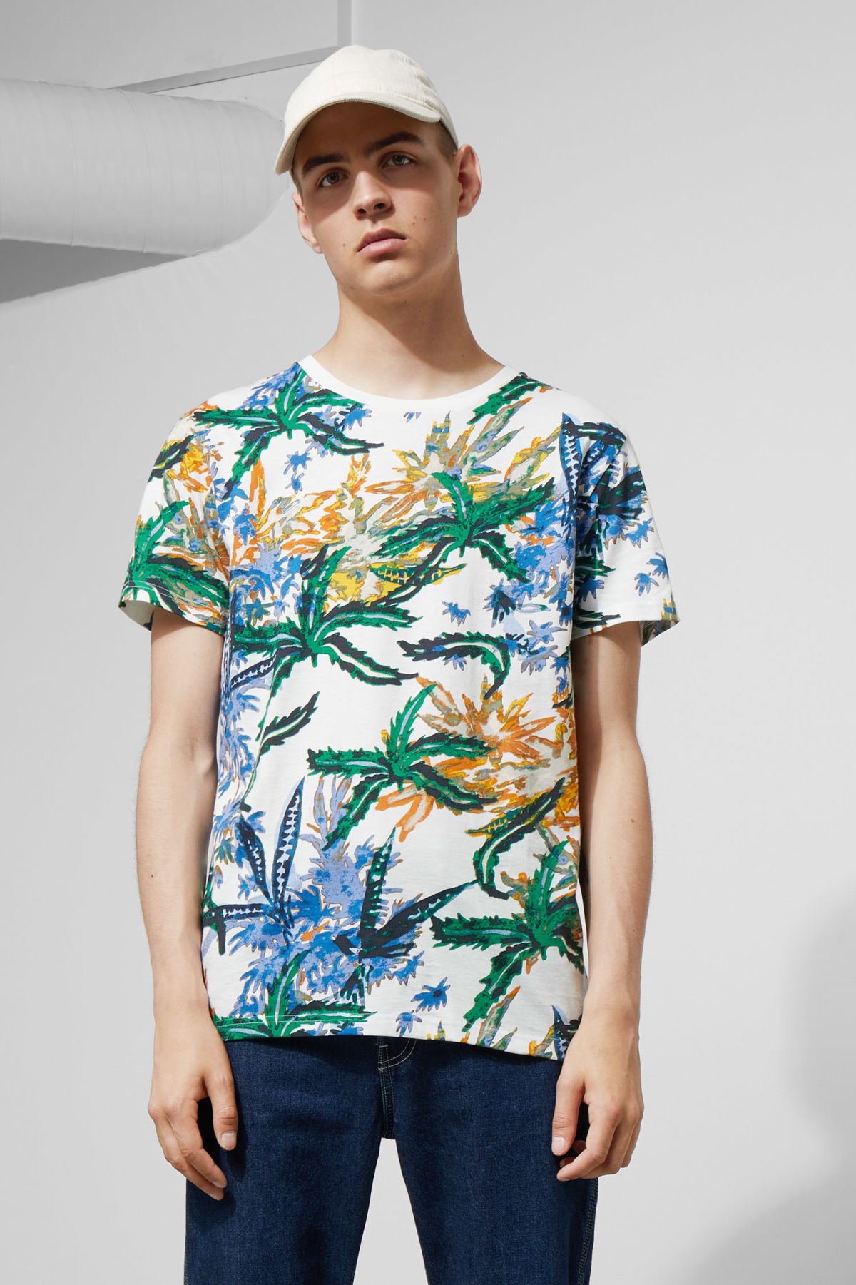 Model front image of Weekday alex tropical fire t-shirt in white