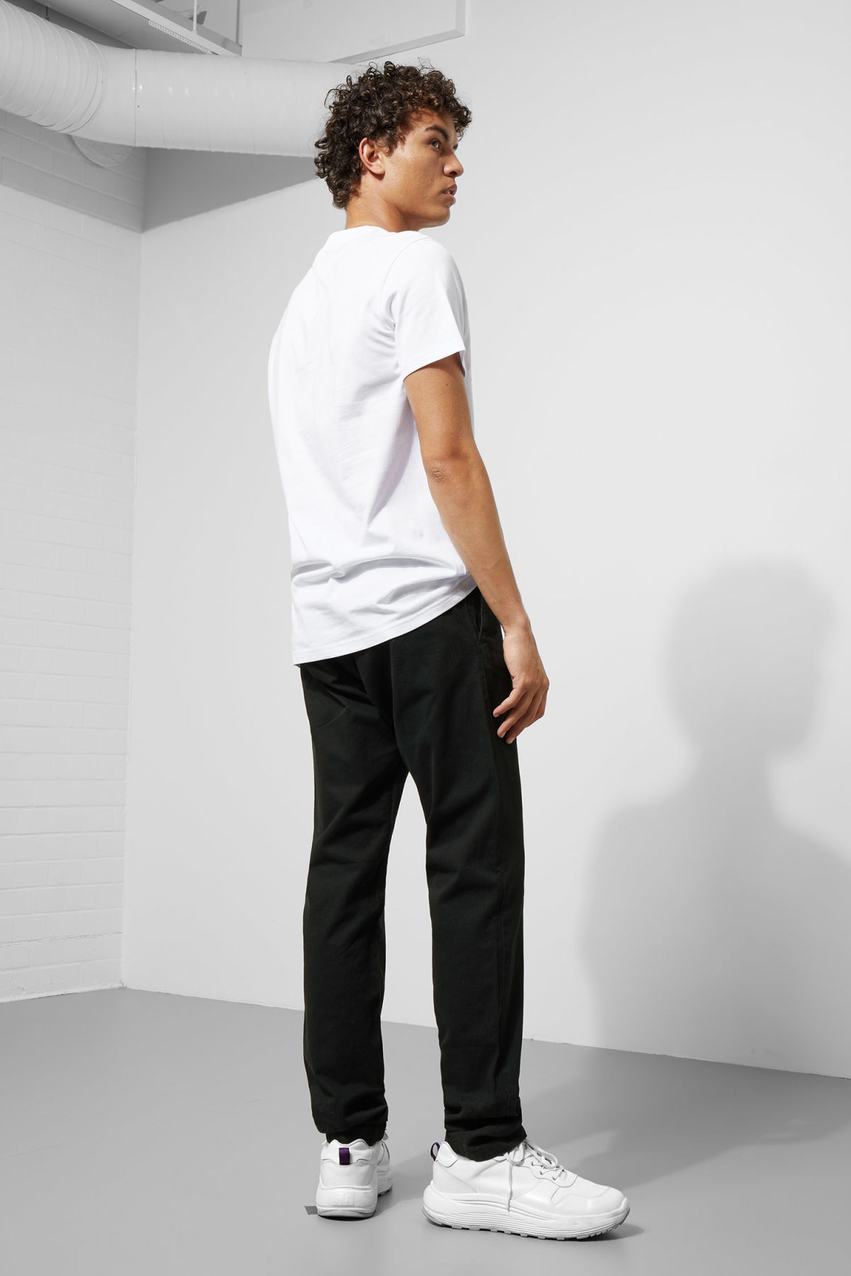 Model side image of Weekday alan cwi t-shirt in white