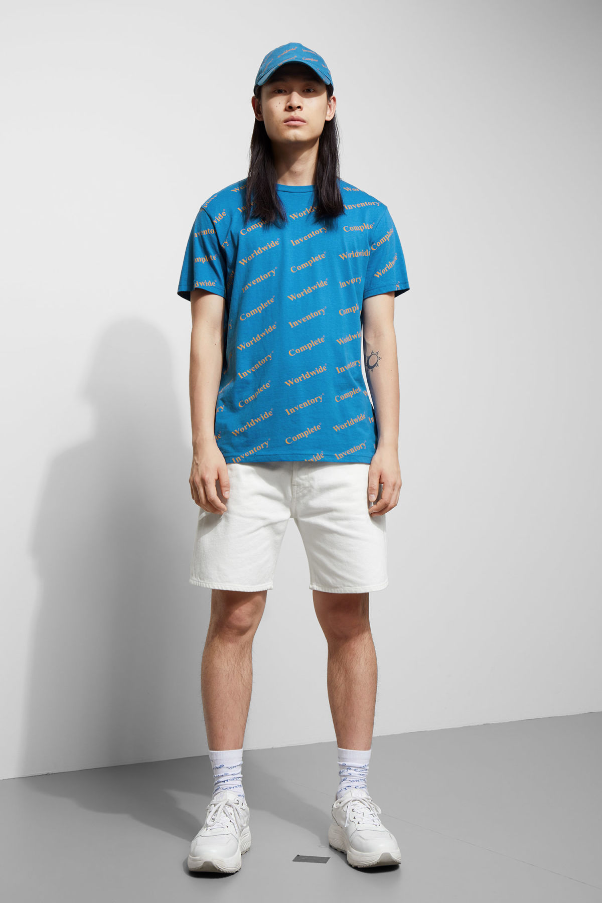 Model side image of Weekday alan complete t-shirt in blue