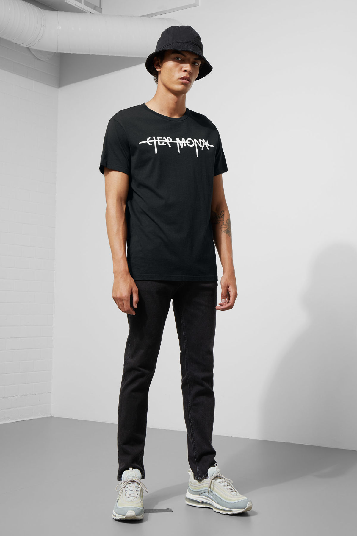 Model side image of Weekday standard hacker logo tee in black