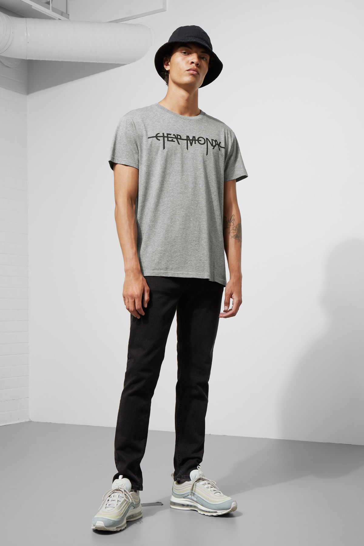 Model side image of Weekday standard hacker logo tee in grey