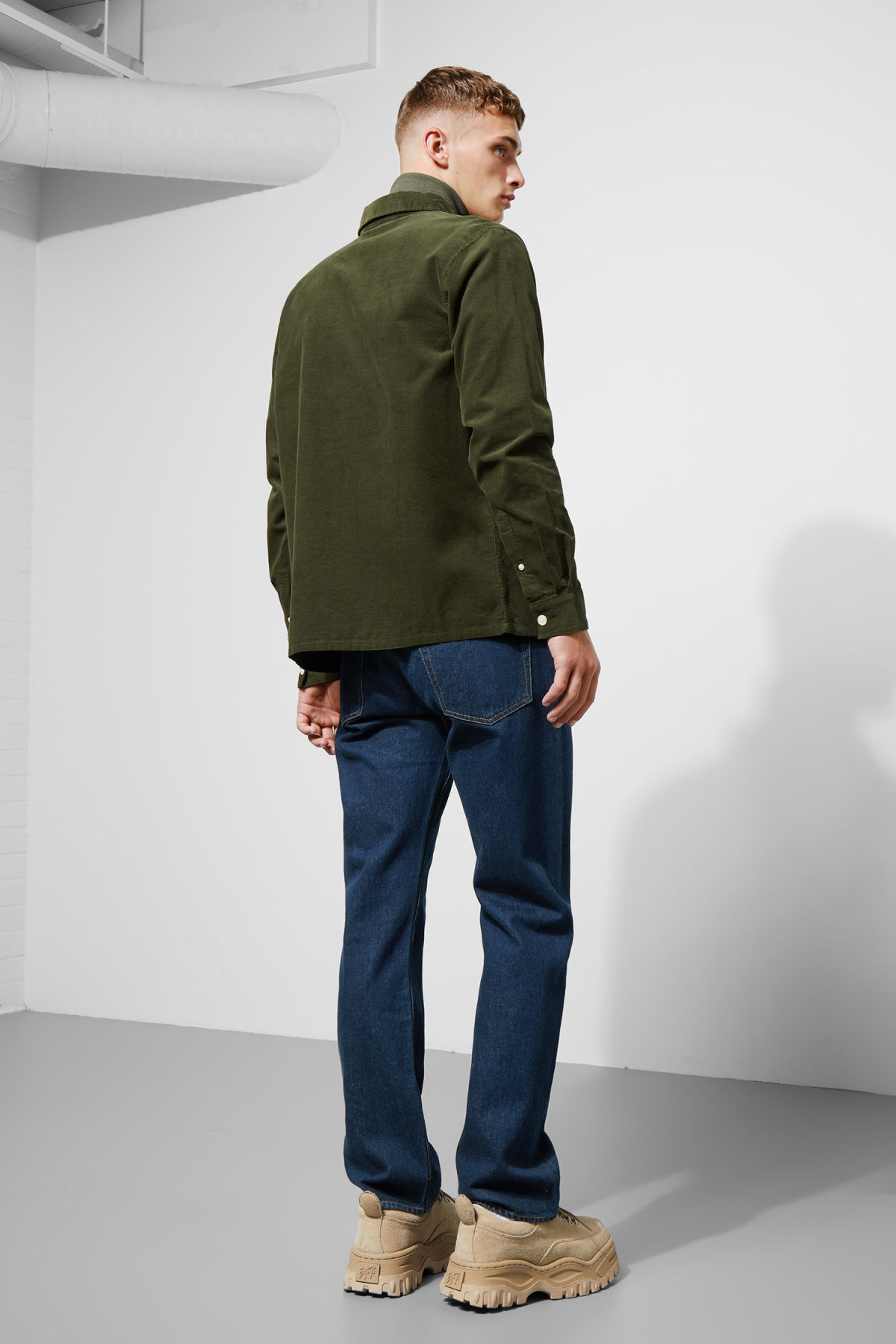 Model side image of Weekday wise cord shirt in green