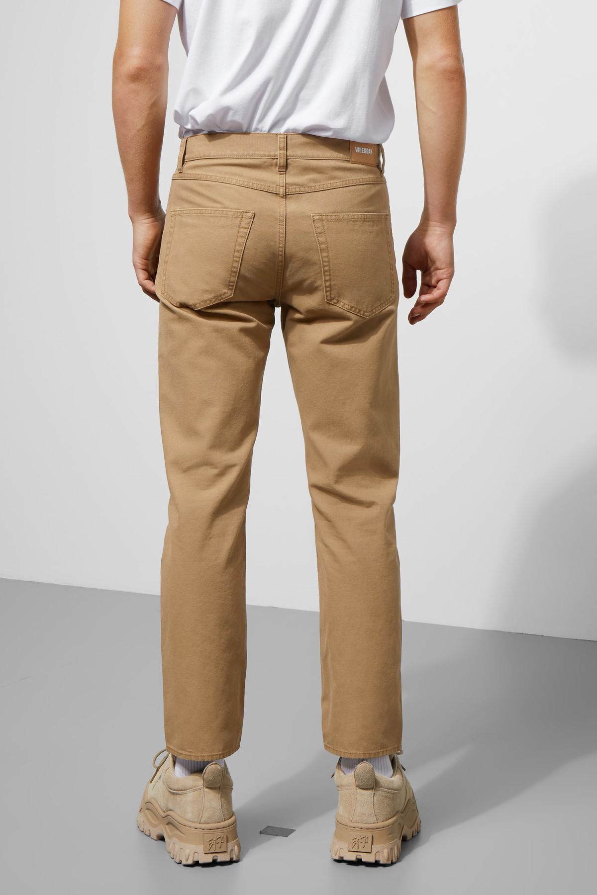 Model back image of Weekday vacant cropped canvas trousers in beige