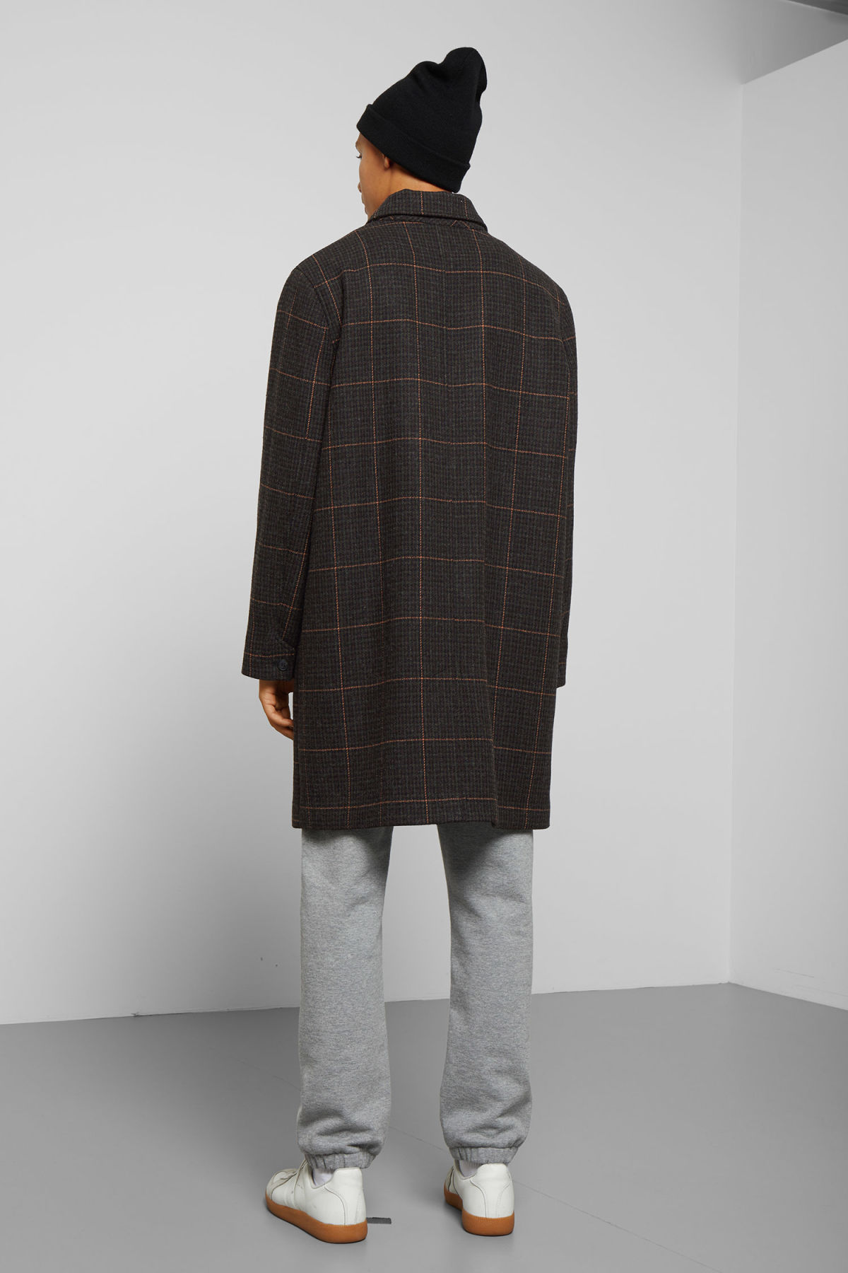Model side image of Weekday carver checked coat in black