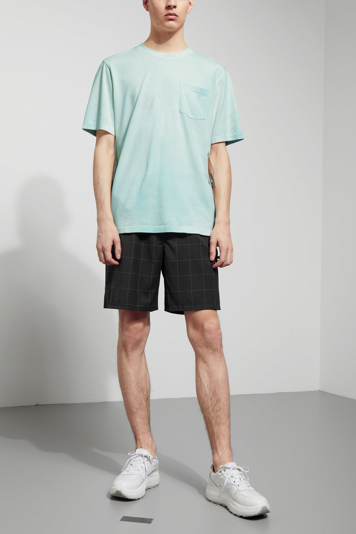 Model side image of Weekday heat t-shirt in green