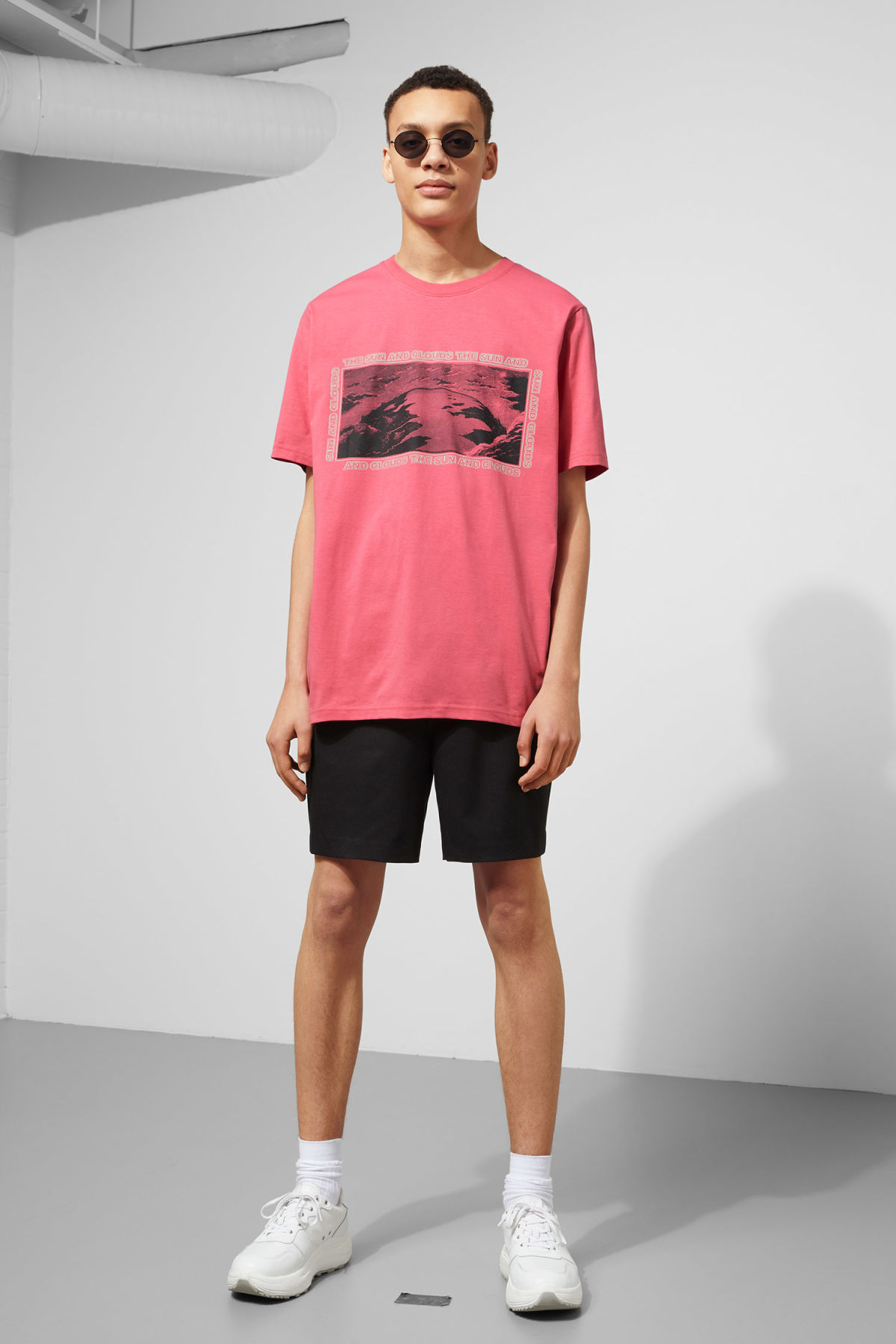 Model side image of Weekday frank sun t-shirt in pink