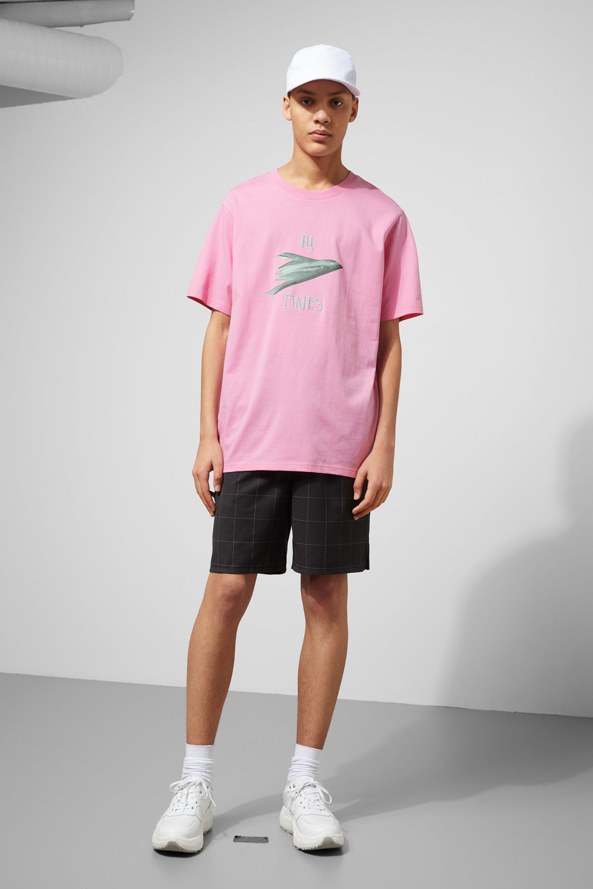 Model side image of Weekday frank times t-shirt in pink