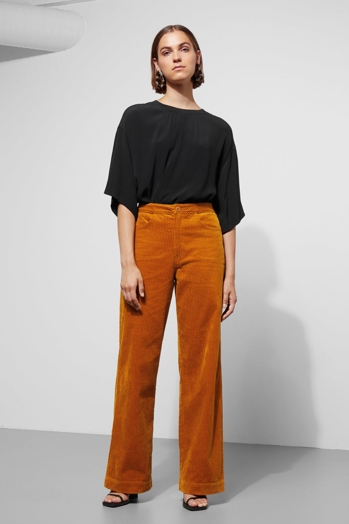 Model front image of Weekday livia trousers in yellow