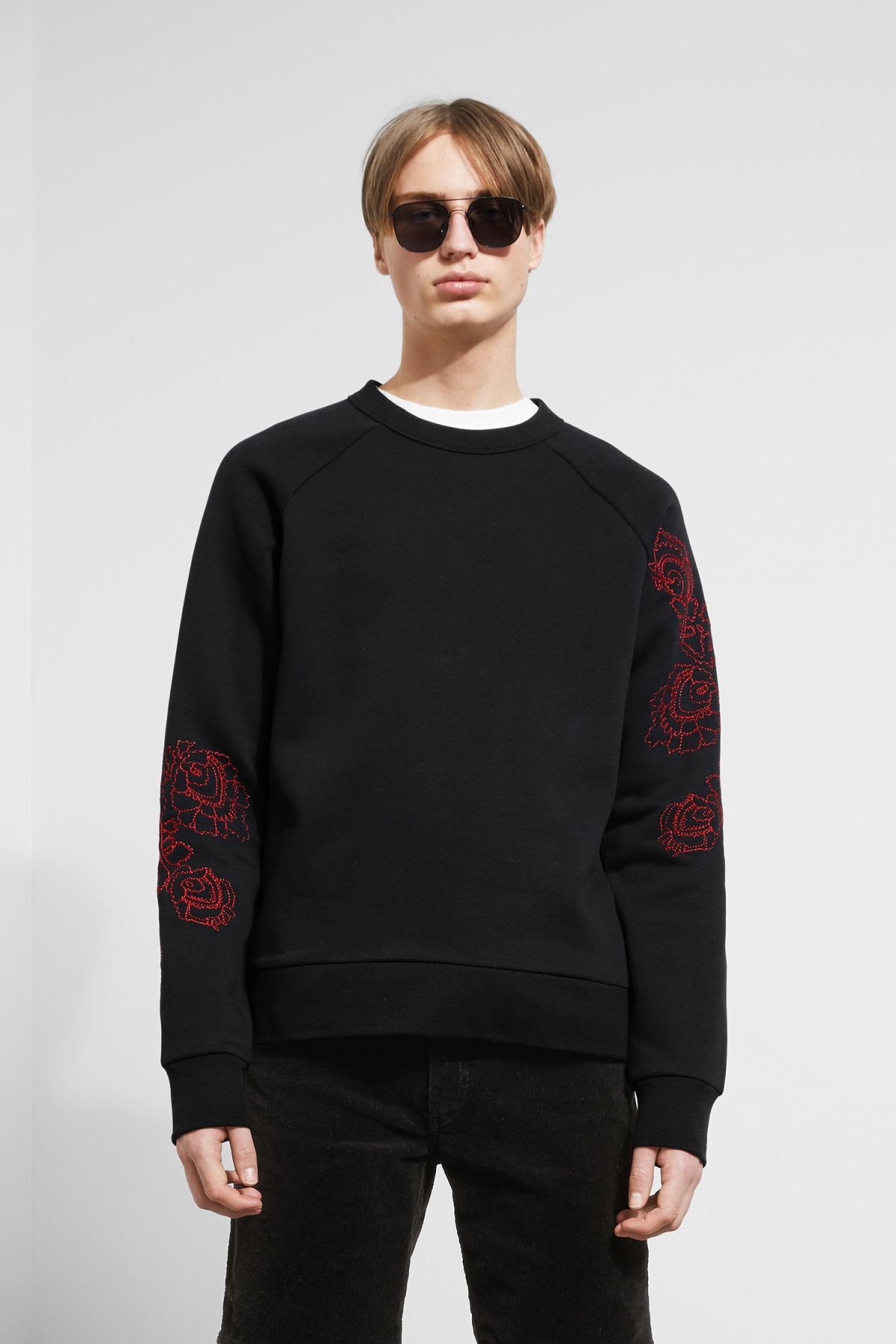 Model front image of Weekday jaxon  wild rose sweatshirt in black