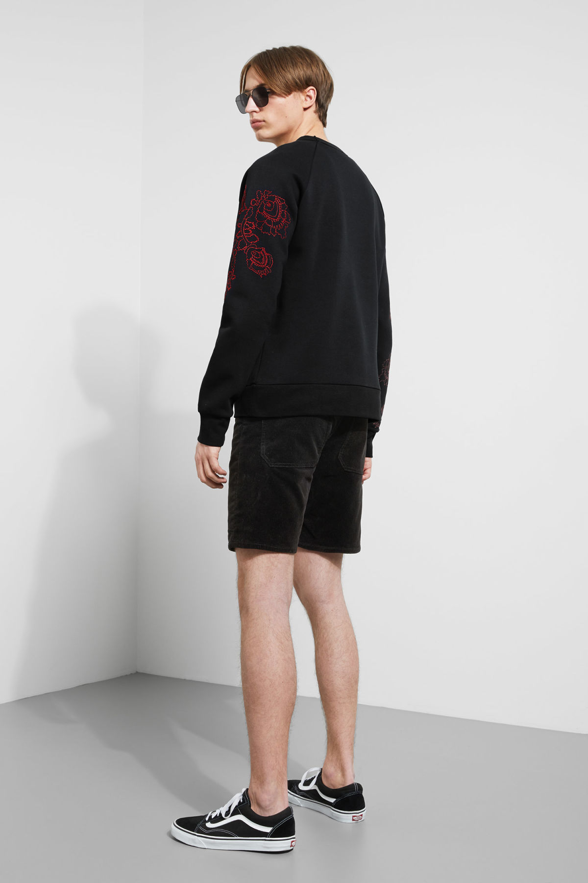 Model back image of Weekday jaxon  wild rose sweatshirt in black
