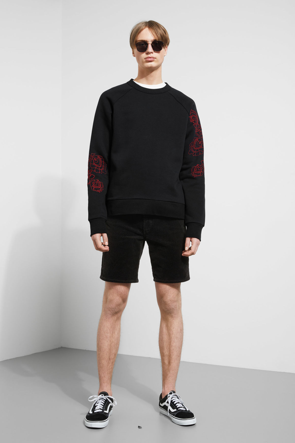 Model side image of Weekday jaxon  wild rose sweatshirt in black