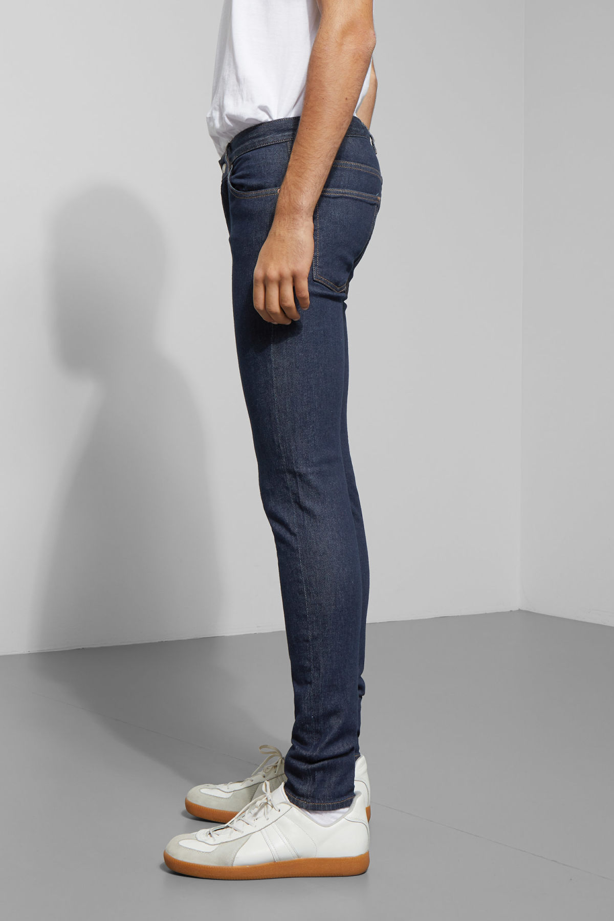 Model side image of Weekday form rinsed jeans in blue