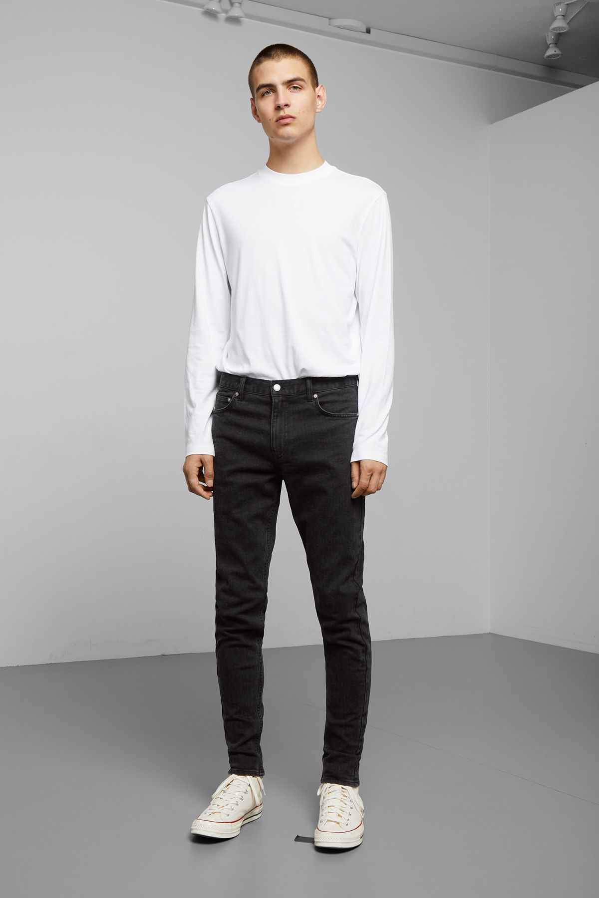 Model front image of Weekday cone tuned black jeans in black