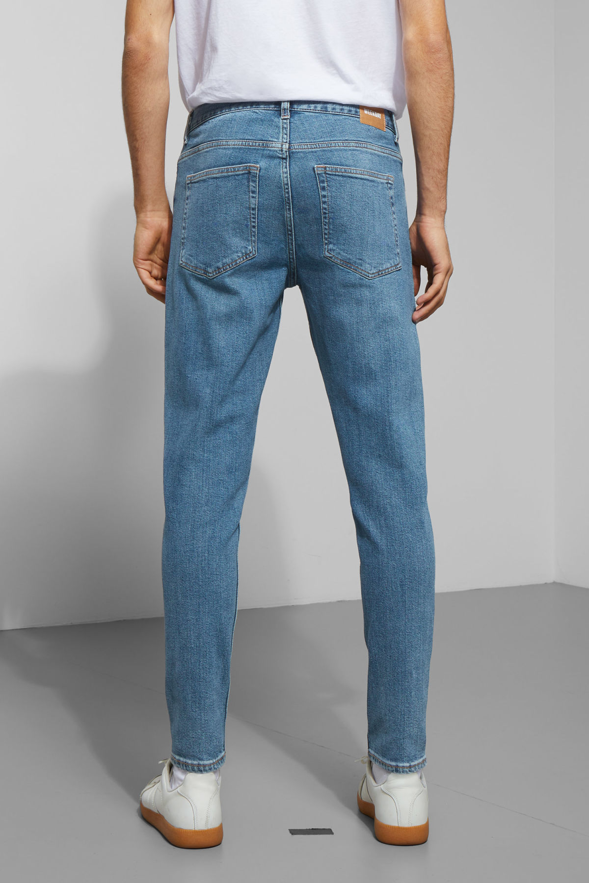 Model side image of Weekday cone ratio blue jeans in blue