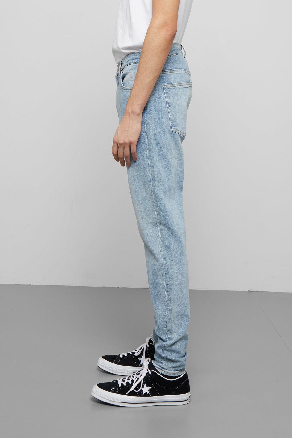 Model side image of Weekday cone bleecker blue jeans in blue