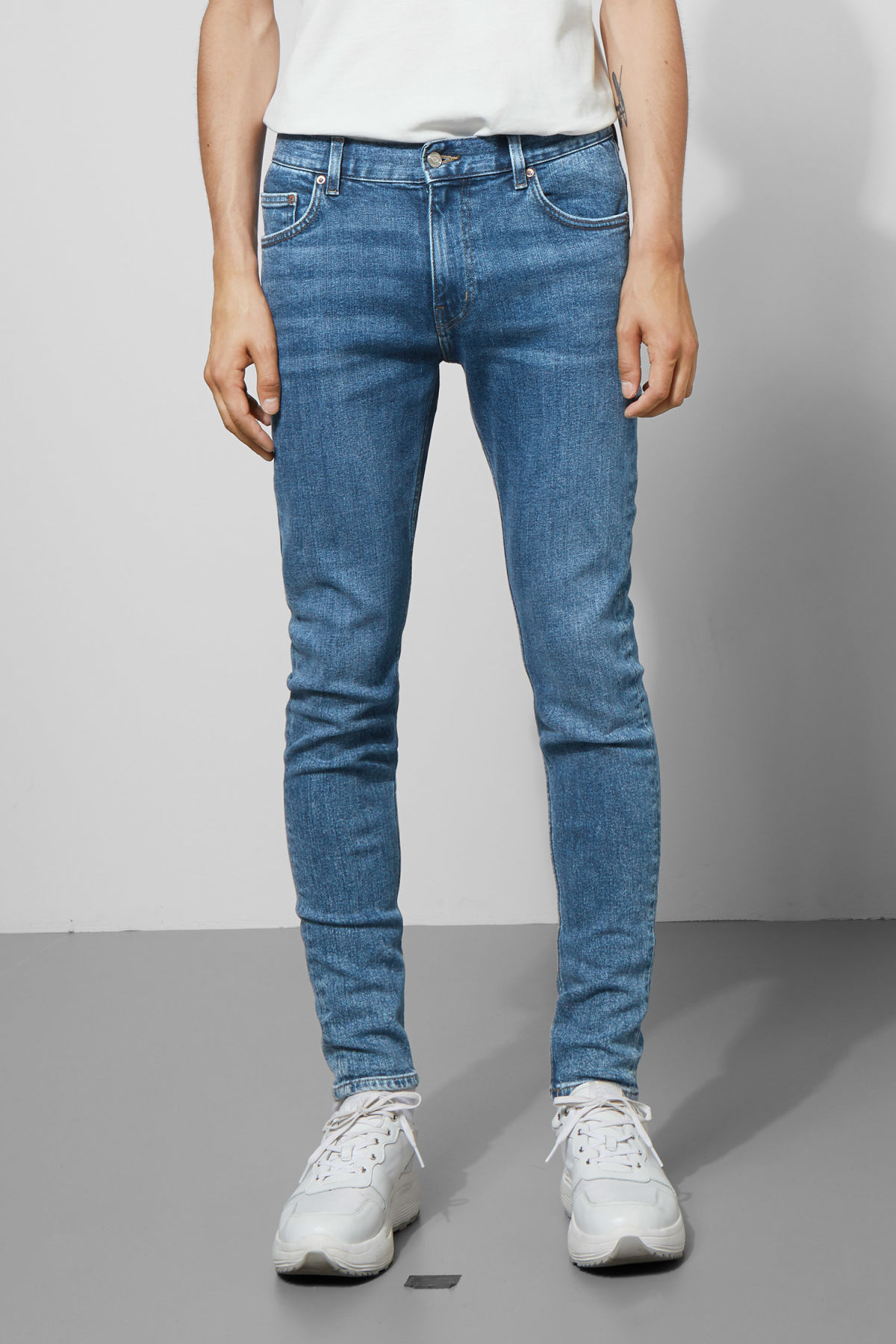 Model side image of Weekday form bleecker mid jeans in blue